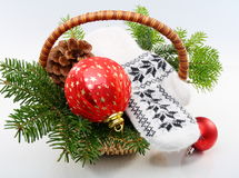 Basket with Christmas tree,balls and pine cones. Royalty Free Stock Images