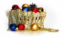 A basket with Christmas-tree decorations Royalty Free Stock Photos