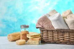 Basket with clean towels, soap and sea salt. On table royalty free stock photo
