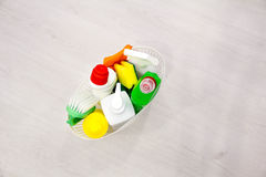 Basket with cleaning items on blurry background place for text, Top view, flat lay with copy space slogan or message Royalty Free Stock Images