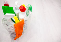 Basket with cleaning items on blurry background place for text, Top view, flat lay with copy space slogan or message Stock Photo