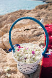 Basket closeup with petals. wedding in cyprus, bride and groom on a stone bridge in Agia Napa. arch and table for Stock Image