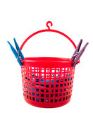 Basket with clothespins Stock Photography