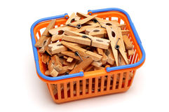 Basket with clothespins Stock Photos