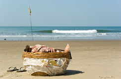 Basket of coconut seller in Vagator beach Royalty Free Stock Photos
