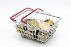 Basket with coins for retail business. Image use for online and offline shopping, marketing place , business concept.  stock photography