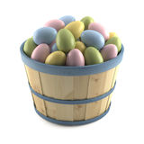 Basket of colored easter eggs. Isolated on white background Royalty Free Stock Photos