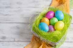 Basket with colored Easter eggs Royalty Free Stock Image