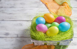 Basket with colored Easter eggs Royalty Free Stock Photography