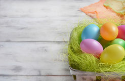 Basket with colored Easter eggs Royalty Free Stock Images