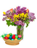Basket with colored easter eggs and transparent vase Stock Photography