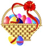 Basket with colored eggs Stock Image