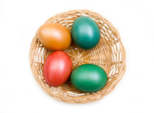 Basket with colored eggs from above Stock Image