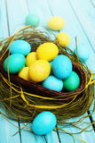 Basket of colored eggs Royalty Free Stock Image