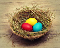 Basket with colored eggs Stock Photo
