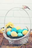 Basket of colored eggs, tinted Royalty Free Stock Images