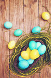 Basket of colored eggs, tinted Stock Photo