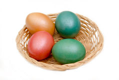 Basket with colored eggs Royalty Free Stock Image