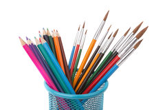 Basket with colored pencils and brushes for painting. Royalty Free Stock Photos