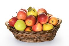 Basket with colorful apples. On white background stock photos