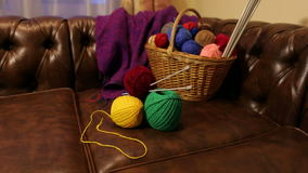 Basket with colorful balls of wool. stock video footage