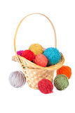 Basket with colorful balls of yarn Stock Photo