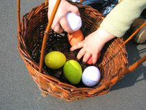 Basket with colorful easter eggs stock photography