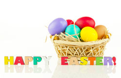 Basket with the colorful Easter eggs Stock Images