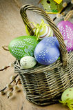Basket with colorful Easter eggs stock images
