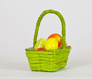 Basket with Colorful eggs Stock Photo