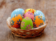 Basket of colorful eggs stock photography