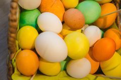 Basket with colorful eggs on agricultural farm market, top view royalty free stock photography
