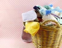 Basket of colorful socks on pink polka dot background Royalty Free Stock Photography