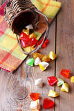 Basket with colorful sweet candies Stock Photos