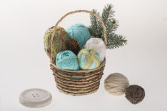 Basket with colorful yarns decoarted with pine brunch Stock Photo