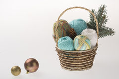Basket with colorful yarns decoarted with pine brunch Stock Photography