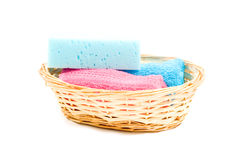 Basket with colorfull towels and sponge Stock Images
