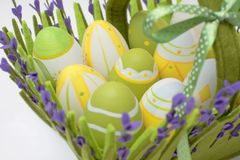 Basket with colourful eggs Stock Photo