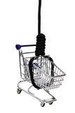Basket of commodities on gibbet. Shopping addiction - basket of commodities on gibbet stock photo