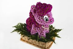 Basket with a composition of fresh cut flowers in the form of My Little Pony royalty free stock photography