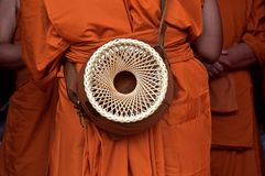 A basket contain alm bowl. A basket contain alm bowl during the ordain into monkhood at the temple Stock Photo