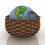 Basket containing a globe Stock Photos