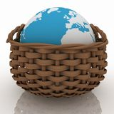 Basket containing a globe Royalty Free Stock Photos