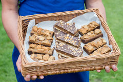 A basket containing slices of cakes and brownies Stock Image
