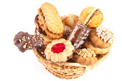 Basket with a cookie. Basket is gap-filling a delicious cookie on a white background Stock Photography