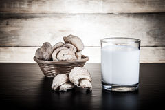 Basket of cookie and glass of milk on a black table against old Stock Images
