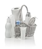 Basket with cosmetics, paper towel and hairbrush Royalty Free Stock Image