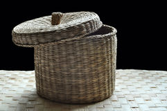 Basket cover slightly opened. A basket made of reed with cover slightly opened Stock Images