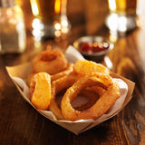 Basket of crispy onion rings with beer Royalty Free Stock Images