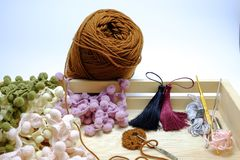 A basket of crochet yarn,tassel and crochet hook. On white background Royalty Free Stock Photography